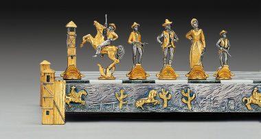 """Ensemble """"Cow Boy vs Indiens"""" Echiquier et Jeu d'Echecs en Bronze, Onyx et Or 24 Carats"""